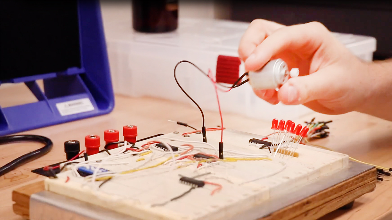 Photo of a hand holding electronics in the Maker Studio