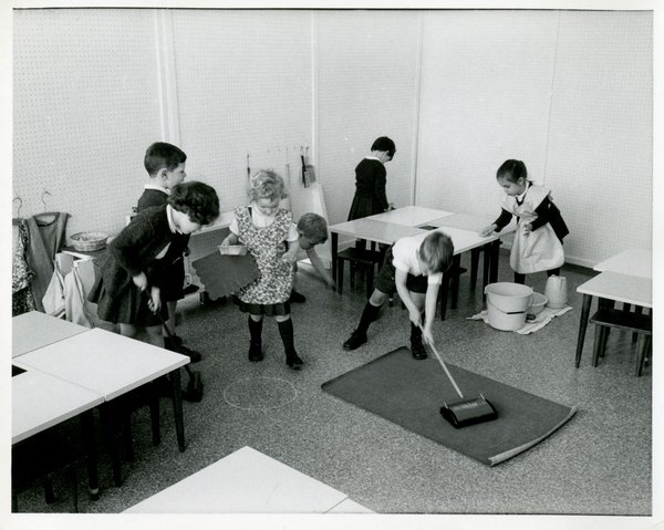 Students work together to clean a classroom
