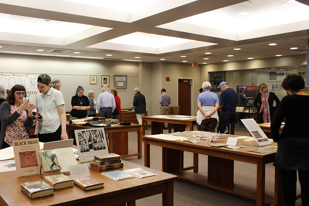 Photo of event in archives and special collections reading room, people looking at materials