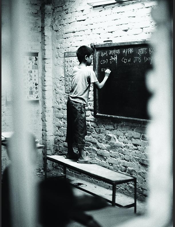 School Boy at Chalkboard